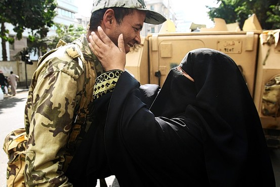 Mother and soldier son at a checkpoint in Cairo, Egypt.  (European Pressphoto Agency)